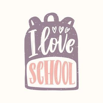 Я люблю школу сообщение написано с курсивным каллиграфическим шрифтом на рюкзаке.