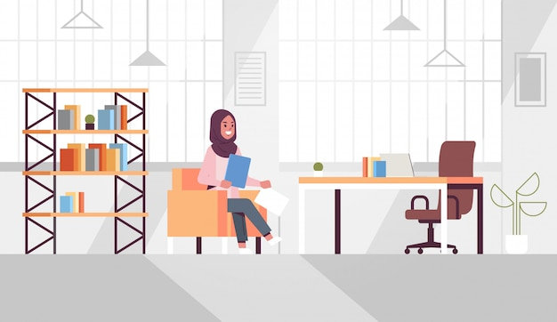 Ic businesswoman sitting at workplace desk arab business woman holding paper documents preparing report working process concept modern office interior flat horizontal
