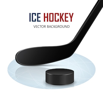 Хоккейная клюшка и шайба на катке.