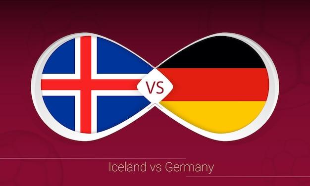 Исландия против германии в футбольном соревновании, значок группы j. versus на футбольном фоне.