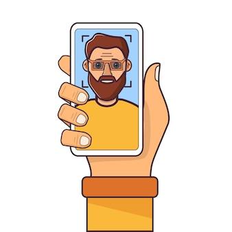 顔認識。顔id。スマートフォンを持っている人間の手。ひげを持つ若者。