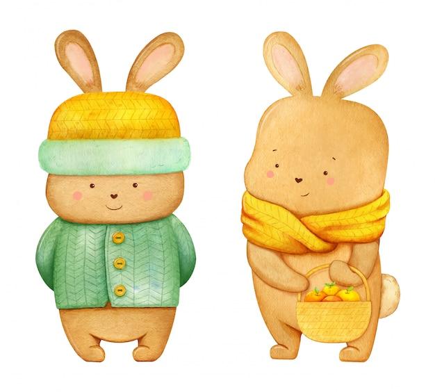 りんごがいっぱい入ったバスケット付きの黄色いスカーフの笑顔のうさぎキャラクターと、黄色い毛皮の帽子と緑のセーターのある笑顔のうさぎのイラスト。手描きの水彩画