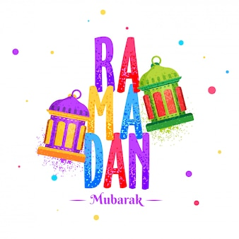Illuminated lanterns with colorful text ramadan