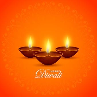 Illuminated oil lamps (diya) on orange background for happy diwali celebration