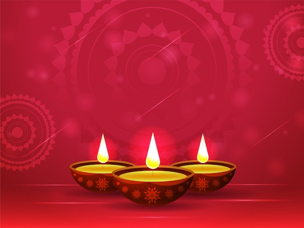 Illuminated oil lamps (diya) on red mandala pattern background.