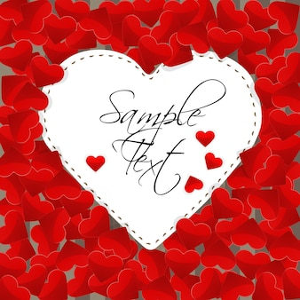 Illustration of big white paper heart on a background made of small red hearts
