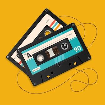 오렌지 배경에 고립 된 그림 깨진 된 빈티지 오디오 테이프.