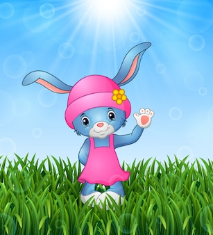 Illustration of cute rabbit cartoon waving in the grass on a background of bright s