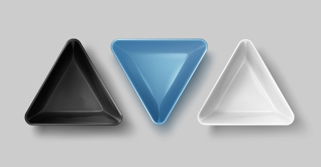 Illustration of empty black, blue and white triangular ceramic bowls on gray background, top view