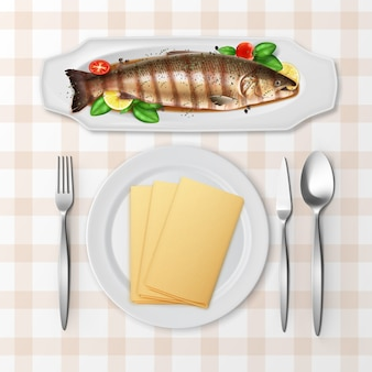 Illustration of grilled trout fish served with tomatoes, basil and lemon in sauce on white platter with cutlery on checkered tablecloth, top view
