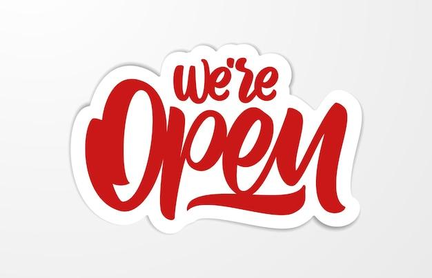 Illustration: handwritten calligraphic lettering of we're open