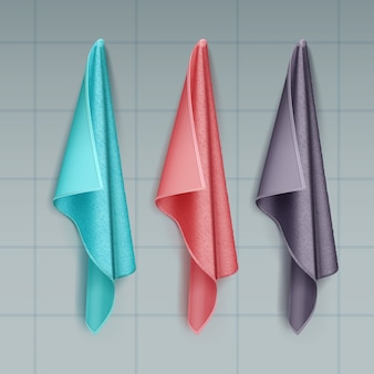 Illustration of hanging colored cotton or terry towels draped isolated on tiled wall