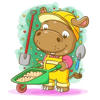 The illustration of the hippopotamus pull the sand on the green wheelbarrow