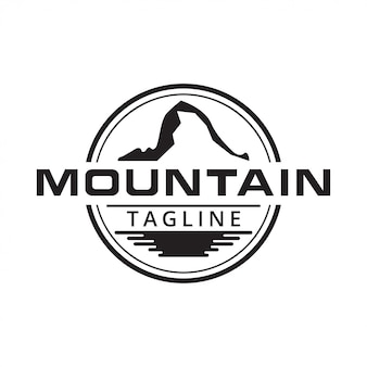 Illustration of mountain and water surface logo design
