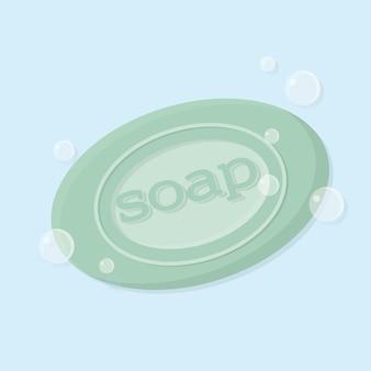거품이 있는 비누의 단단한 막대 그림 비문이 있는 녹색 고체 비누