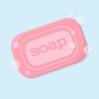 거품이 있는 비누의 단단한 막대 그림 비문이 있는 분홍색 고체 비누
