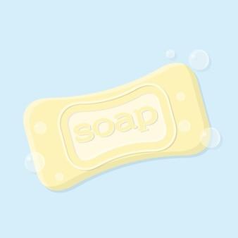 거품이 있는 비누의 단단한 막대 그림 비문이 있는 노란색 고체 비누