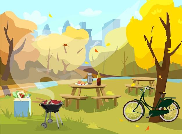 公園の秋の風景のイラスト。サンドイッチ、魔法瓶、ワイン付きのピクニック用のテーブル。フード付きバーベキュー、製品付きクーラーバッグ。木の近くの自転車。背景の都市。 。