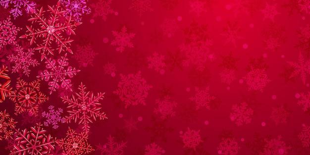 雪が降る背景の左側にある赤い色の大きな複雑な半透明のクリスマスの雪片のイラスト