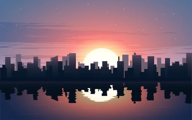 川と夕暮れ時のシティービューのイラスト