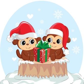 Иллюстрация пары обезьяны с подарочной коробкой. милая обезьяна на рождество.