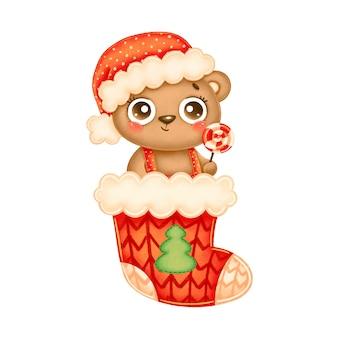 赤いクリスマス靴下にロリポップと赤い帽子をかぶってかわいい漫画のクリスマスクマのイラスト