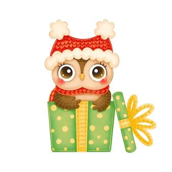 赤い帽子と緑のギフトボックスのスカーフでかわいい漫画のクリスマスフクロウのイラスト