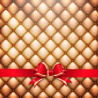 赤いギフト弓と黄金のリアルな張り革パターン背景のイラスト。