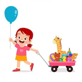 幸せなかわいい女の子のイラストは、ワゴンでおもちゃをもたらす