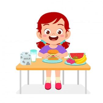 幸せなかわいい女の子のイラストは、健康的な食べ物を食べる