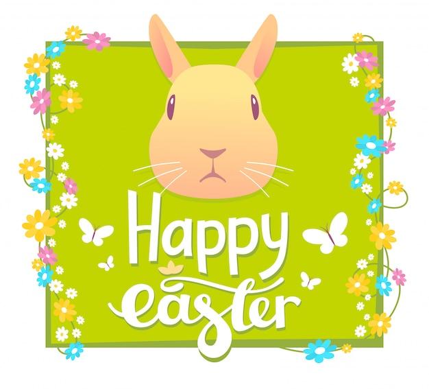 꽃 프레임와 녹색 배경에 노란 토끼의 머리와 함께 행복 한 부활절 인사의 그림.