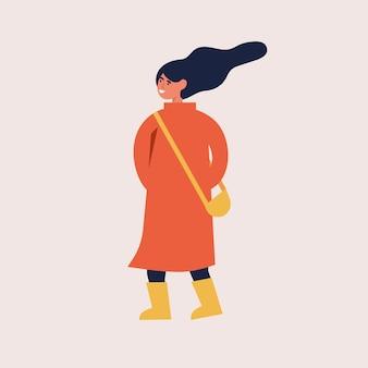 秋の服で幸せな女のイラスト。若い女の子が歩いています。