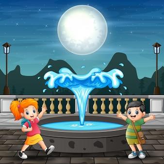 噴水の周りで遊んでいる子供たちのイラスト