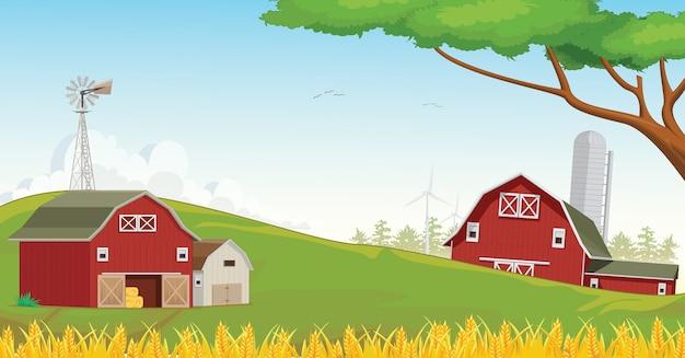 빨간 농장 헛간과 산 시골의 그림