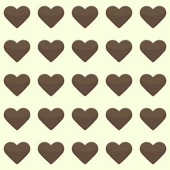 Иллюстрация бесшовные модели с милыми коричневыми сердечками на желтом фоне