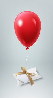 Иллюстрация небольшой подарочной коробки с бантом и бумажной карточкой на воздушном шаре
