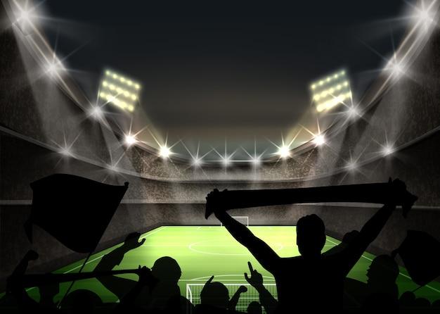 明るいスポットライトとスタジアムのイラストは、緑のサッカー場とファンのシルエットを照らします