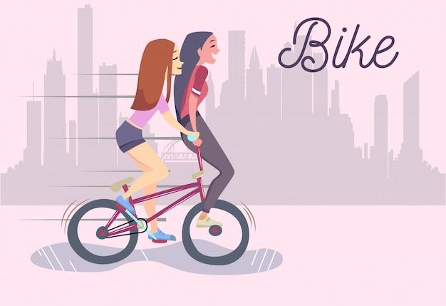 自転車に乗って2つのかわいいおしゃれな女の子のイラスト