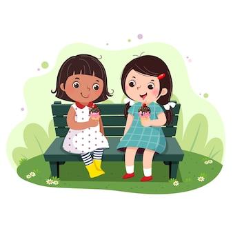 벤치에 아이스크림을 먹는 두 어린 소녀의 그림.
