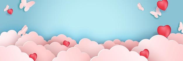 핑크 발렌타인 개념에 나비와 종이 예술 구름. 하늘을 나는 나비. 크리 에이 티브 디자인 종이 컷 및 공예 스타일 종이 접기 흐림 및 하늘 풍경 파스텔 색상