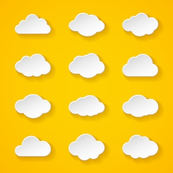 Illustration of twelve white paper clouds with different shapes and shadow
