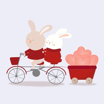 Illustrazione di due conigli su una bicicletta che trasportano palloncino sul retro.