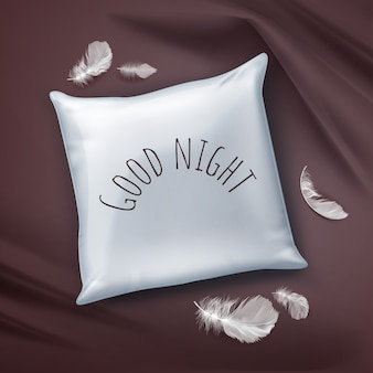 Illustration white square pillow with text and feathers on burgundy bed sheet