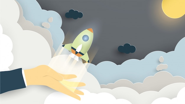 Illustration with start up concept in paper cut, craft and origami style. rocket is flying.