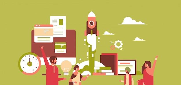 新しい成功したスタートアッププロジェクトコンセプトを作成するインドのビジネス人々