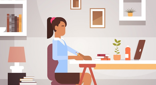 Indian business woman sitting desk working businesswoman office
