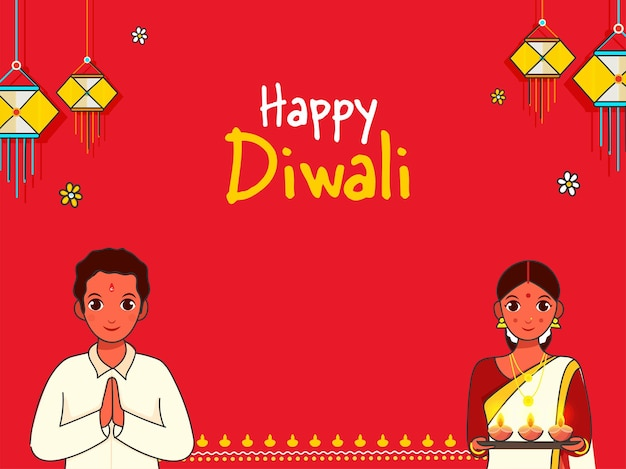 Индийская пара делает намасте (приветствие) и держит тарелку с масляной лампой (дия) по случаю празднования счастливого дивали.