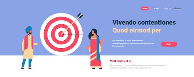 Indian couple standing target arrow goal success business concept