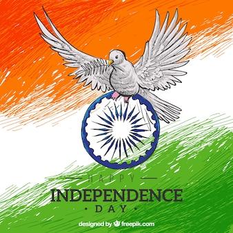 インドの旗の背景の手は鳩で描か