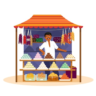 Indian man selling  traditional asian sweets